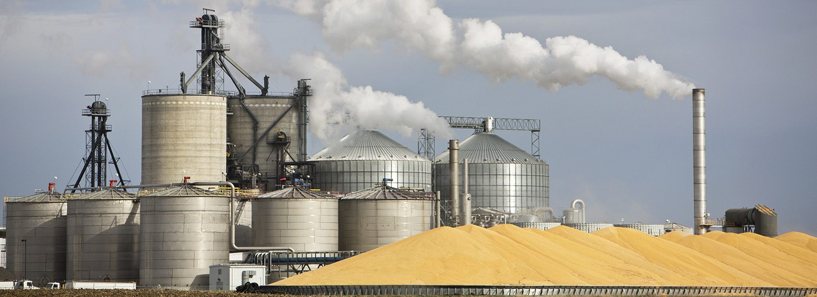 Ethanol Plant and Large Pile of Corn in The Midwest.